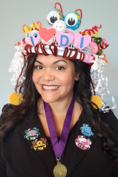 Michelle Talkington is wearing a DI hat she created for the Hats On For Creativity fundraising challenge.